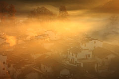 Chinese village in dawn fog Stock Photo