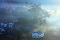Chinese village in dawn fog Stock Image