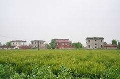 Chinese village houses and farm land Royalty Free Stock Photography