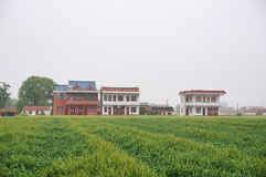 Chinese village houses and farm land Stock Photos