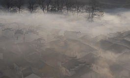 Chinese Village In Morning Fog Stock Images