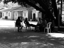 Chinese Village Scene. Chatting in the shade of an old tree Royalty Free Stock Photos