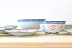 Chinese vintage style blue and white dishes. Plate and bowl on the cupboard at home Stock Photography