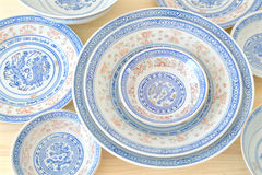 Chinese vintage style blue and white dishes. Plate and bowl on the cupboard at home Royalty Free Stock Images