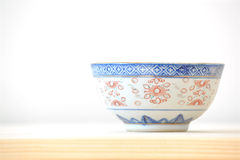 Chinese vintage style blue and white dishes. Plate and bowl on the cupboard at home Royalty Free Stock Photos