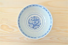 Chinese vintage style blue and white dishes. Plate and bowl on the cupboard at home Stock Photos