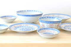 Chinese vintage style blue and white dishes. Plate and bowl on the cupboard at home Stock Image