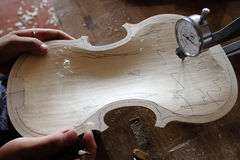 Chinese violin craftsmanship Royalty Free Stock Image