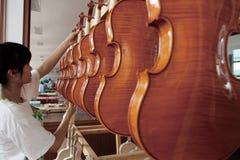 Chinese violin craftsmanship Royalty Free Stock Image