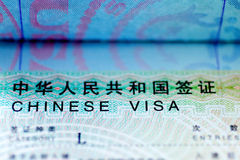 Chinese Visa. In a passport with focus on the words Royalty Free Stock Photo