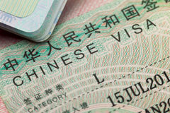 Chinese visa in a passport - enjoy travel Royalty Free Stock Photography