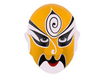 Chinese war mask. A yellow chinese war mask on a white background Stock Photo
