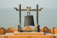 Chinese warning bell on coastline Stock Photos