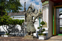 Chinese Warrior Statue In The Wat Pho, Bangkok, Thailand. Ancient warrior ststue in Wat Pho temple in Thailand Royalty Free Stock Photo