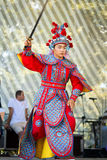 Chinese warrior with sword. Moscow, Russia - July 31, 2016: the performance of the Chinese show Golden Dragon Drumpst in the open air during the celebration of Stock Images