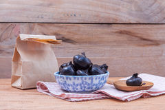 Chinese water chestnut ,water nut or Matai roots in the bowl and. Paper bag on rustic old wooden background royalty free stock images