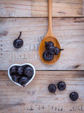 Chinese water chestnut ,water nut or Matai roots in wooden spoon. And bowl on rustic old wooden background stock image
