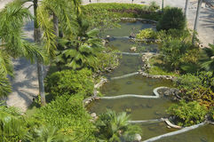Chinese water garden. Birds eye view of a new Chinese water garden of hotel, showing water-level wall-enclosed incremental step-down of tier of ponds. Submerged Royalty Free Stock Photos