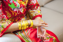 Chinese wedding ceremony with gold bangles Royalty Free Stock Image