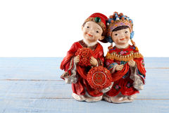 Chinese Wedding Figurines. On Wooden Background Stock Images