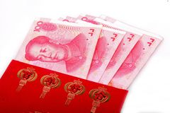 Chinese wedding red packets. Chinese red packets and Renminbi currency.Here is gives newlyweds' red package at the wedding ceremony Stock Photography