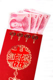 Chinese wedding red packets. Chinese red packets and Renminbi currency.Here is gives newlyweds' red package at the wedding ceremony Royalty Free Stock Image