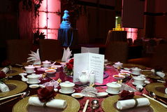 Chinese wedding setting. Details of a chinese wedding banquet table setting with background of stage and two tier wedding cake Royalty Free Stock Photography