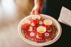Chinese Wedding Tea Ceremony. Traditional Chinese wedding tea ceremony cups on decorative plate Royalty Free Stock Image