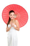 Chinese wedding woman with red paper umbrella Stock Photo