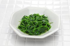 Chinese white wine stir fried with toothed bur clover Royalty Free Stock Photos