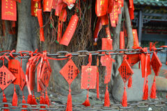Chinese wishes. Chinese good luck wishes hanging from a chain Royalty Free Stock Image
