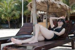 Chinese woman. Beach sunbathing woman, laid-back holiday Stock Photos
