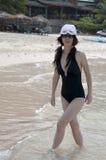 Chinese woman. Beach sunbathing woman, laid-back holiday Royalty Free Stock Image
