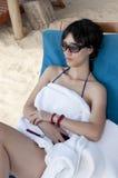 Chinese woman. Beach sunbathing woman, laid-back holiday Stock Photo