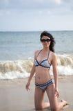 Chinese woman. Beach sunbathing woman, laid-back holiday Stock Image