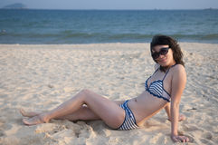 Chinese woman. Beach sunbathing woman, laid-back holiday Stock Images