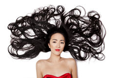 Chinese woman. Beautiful chinese woman lying down on the floor with long hair Royalty Free Stock Photography