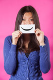 Chinese Woman. Holding Smiling Emoticon Stock Images