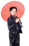 Chinese woman. Chinese women in kimono outfit holdin umbrella royalty free stock photo
