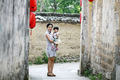 Chinese woman and baby in cheongsam enjoy free time Stock Image