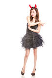 Chinese woman in black dress and devil horns pointing Royalty Free Stock Photo