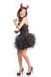 Chinese woman in black dress and devil horns running away Stock Image