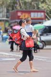 Chinese woman carry her child, Kunming, China Stock Image
