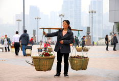 Chinese Woman Carrying Baskets Royalty Free Stock Photography