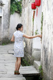 Chinese woman in cheongsam dress enjoy free time Royalty Free Stock Photography