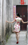 Chinese woman in cheongsam dress enjoy free time Royalty Free Stock Photo