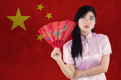 Chinese woman with cheongsam dress and fan Royalty Free Stock Photography