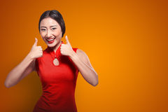 Chinese woman in cheongsam dress show thumbs up Stock Photos