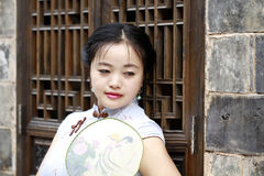 Chinese woman in cheongsam enjoy free time Royalty Free Stock Photo