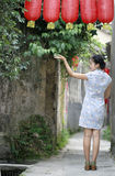 Chinese woman in cheongsam enjoy free time Royalty Free Stock Photography